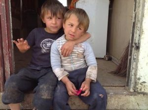 Two children sitting on the step