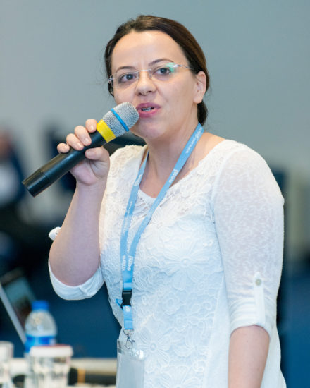 Georgi speaking at Conference