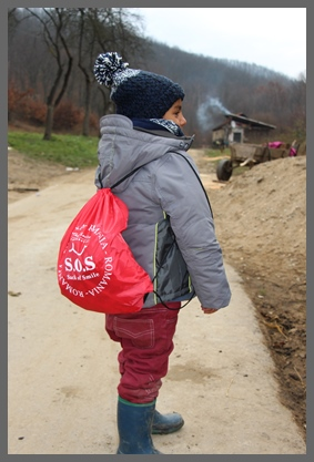 Boy with Sack of Smiles